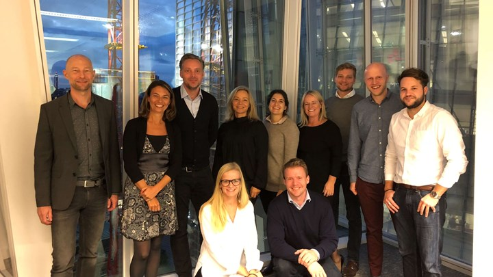 A team of Siteimprove managers posing for the camera in our London office